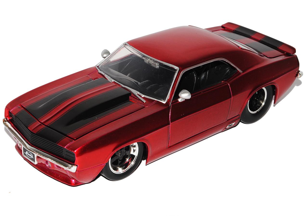 Chevrolet Camaro Coupe metalizado rojo con rayas negras generación 1 1969...