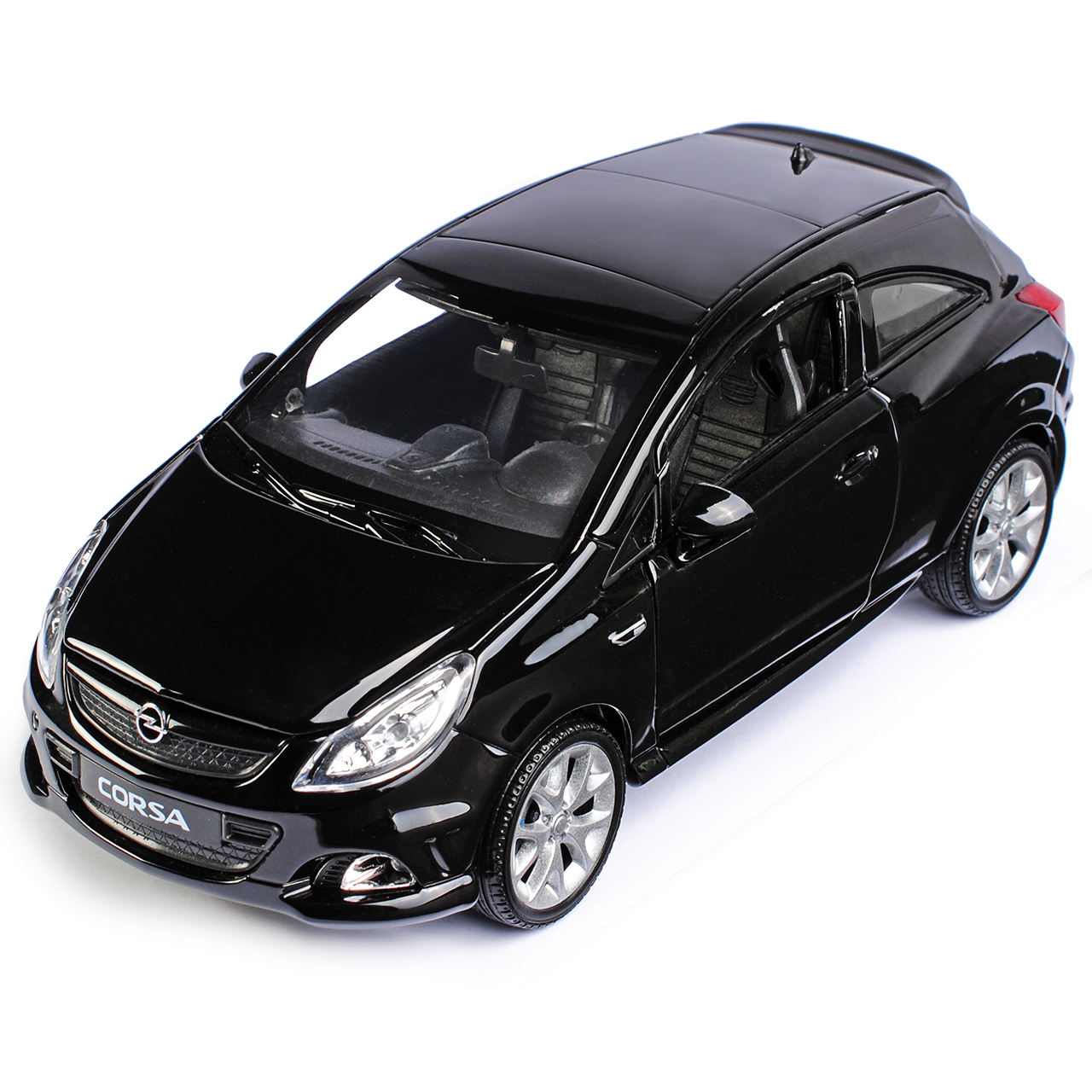 opel corsa d 3 t rer schwarz ab 2006 1 24 welly modell. Black Bedroom Furniture Sets. Home Design Ideas